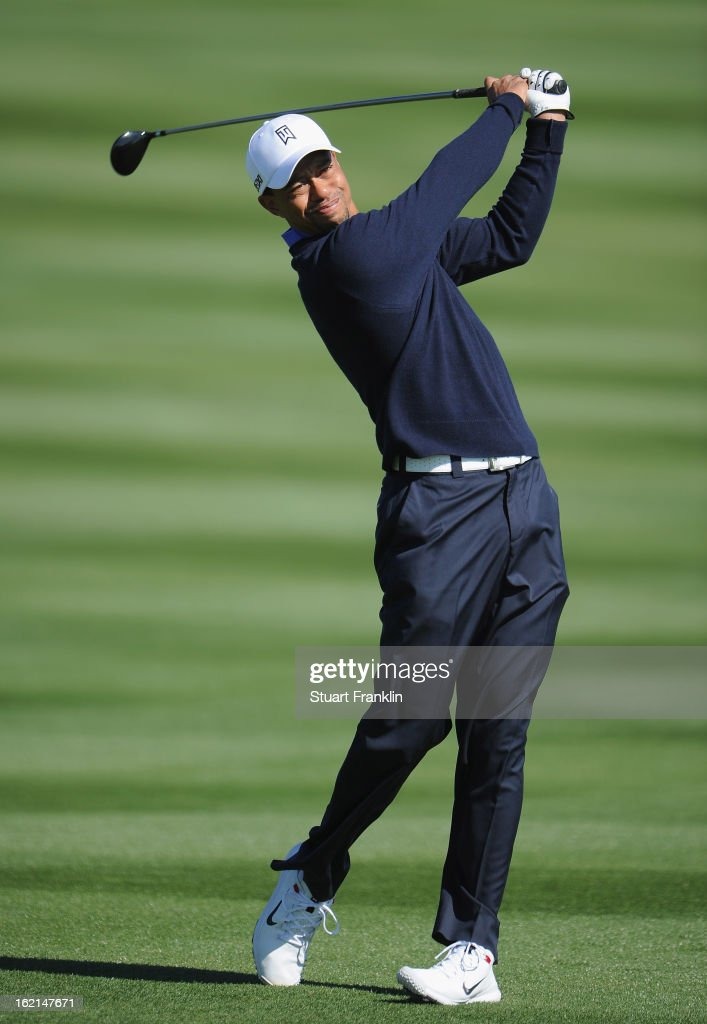 Tiger Woods of USA plays a shot during practice prior to the start of the World Golf ChampionshipsAccenture Match Play Championship at the...