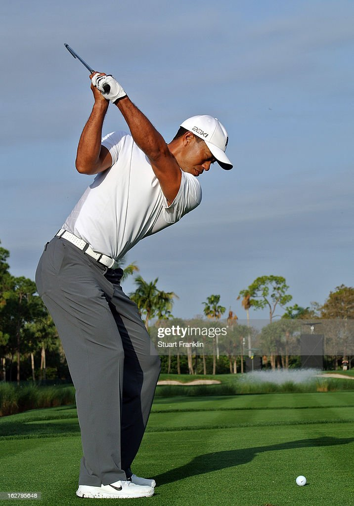 <a gi-track='captionPersonalityLinkClicked' href=/galleries/search?phrase=Tiger+Woods&family=editorial&specificpeople=157537 ng-click='$event.stopPropagation()'>Tiger Woods</a> of USA plays a shot during the pro am of the Honda Classic at PGA National on February 27, 2013 in Palm Beach Gardens, Florida.