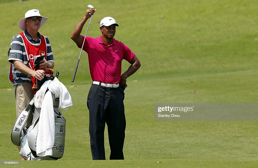<a gi-track='captionPersonalityLinkClicked' href=/galleries/search?phrase=Tiger+Woods&family=editorial&specificpeople=157537 ng-click='$event.stopPropagation()'>Tiger Woods</a> of USA plays his 2nd shot on the 18th hole during day three of the CIMB Classic at The MINES Resort & Golf Club on October 27, 2012 in Kuala Lumpur, Malaysia.