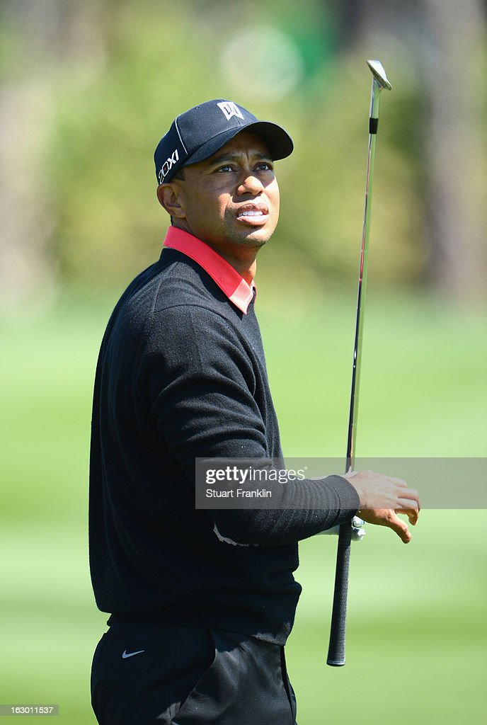 Tiger Woods of USA plays his approach shot on the fourth hole during the final round of the Honda Classic on March 3, 2013 in Palm Beach Gardens, Florida.