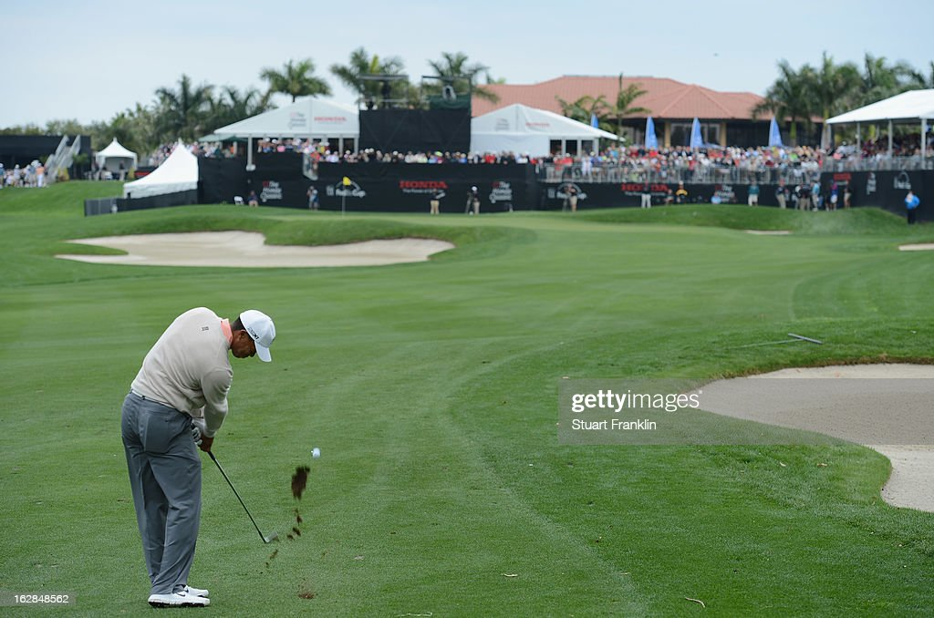 Tiger Woods of USA plays his approach shot on the nineth hole during the first round of the Honda Classic on February 28, 2013 in Palm Beach Gardens, Florida.