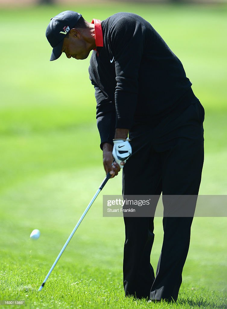 Tiger Woods of USA plays his approach shot on the sixth hole during the final round of the Honda Classic on March 3, 2013 in Palm Beach Gardens, Florida.