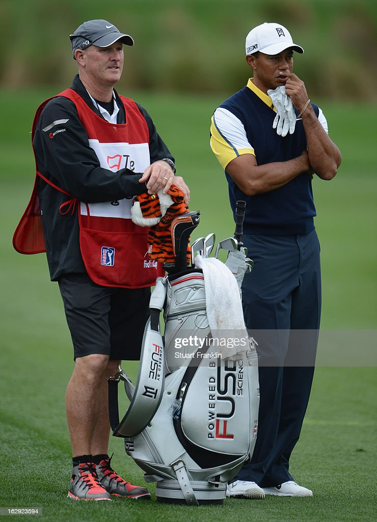 Tiger Woods of USA ponders a shot on the nineth hole with caddie Joe LaCava during the second round of the Honda Classic on March 1, 2013 in Palm Beach Gardens, Florida.
