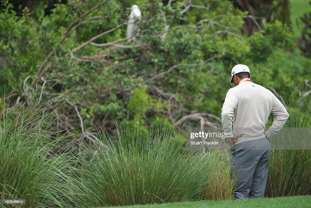 Tiger Woods of USA ponders his approach shot on the sixth hole during the first round of the Honda Classic on February 28, 2013 in Palm Beach Gardens, Florida.
