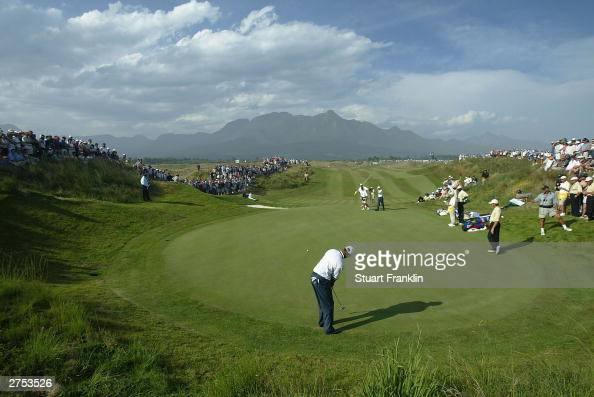 Tiger Woods of USA putting on the 14th green his match against Retief Goosen of South Africa and Vijay Singh of Fiji during the second round of...