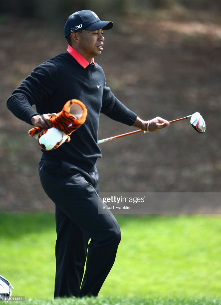 <a gi-track='captionPersonalityLinkClicked' href=/galleries/search?phrase=Tiger+Woods&family=editorial&specificpeople=157537 ng-click='$event.stopPropagation()'>Tiger Woods</a> of USA takes his diver as he returns to the tee to play another shot on the sixth hole during the final round of the Honda Classic on March 3, 2013 in Palm Beach Gardens, Florida.