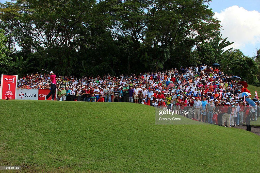 <a gi-track='captionPersonalityLinkClicked' href=/galleries/search?phrase=Tiger+Woods&family=editorial&specificpeople=157537 ng-click='$event.stopPropagation()'>Tiger Woods</a> of USA tees off on the 1st hole during day three of the CIMB Classic at The MINES Resort & Golf Club on October 27, 2012 in Kuala Lumpur, Malaysia.