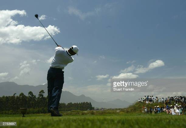 Tiger Woods of USA tees off on the 3rd hole during his match against Retief Goosen of South Africa and Vijay Singh of Fiji during the second round of...