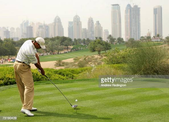 Tiger Woods of USA tees off on the eighth hole during the third round of the Dubai Desert Classic on the Majilis Course at Emirates Golf Club on...