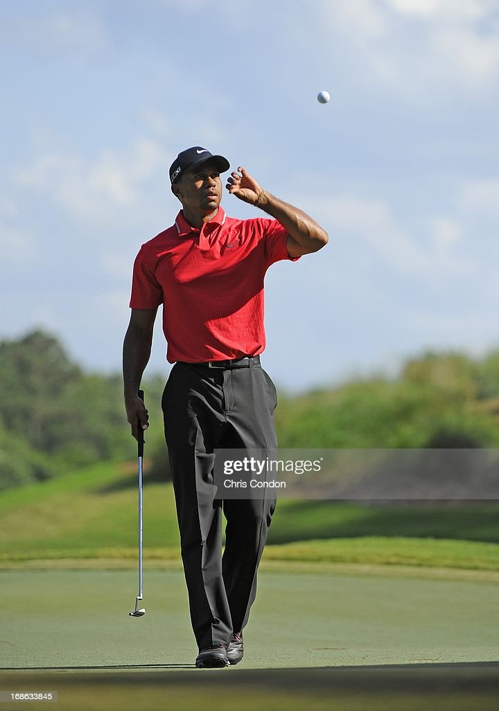 Tiger Woods on the 12th green during the final round of THE PLAYERS Championship on THE PLAYERS Stadium Course at TPC Sawgrass on May 12, 2013 in Ponte Vedra Beach, Florida.