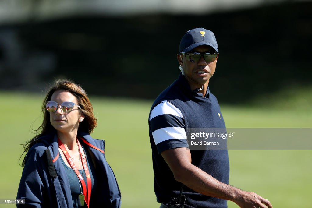 Tiger Woods one of the United States team assistant captain's on the first hole with Erica Herman during the final day singles matches matches in the 2017 Presidents Cup at the Liberty National Golf Club on October 1, 2017 in Jersey City, New Jersey.