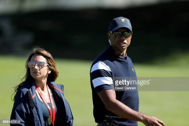 Tiger Woods one of the United States team assistant captain's on the first hole with Erica Herman during the final day singles matches matches in the...