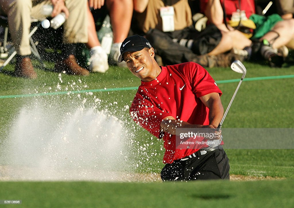 <a gi-track='captionPersonalityLinkClicked' href=/galleries/search?phrase=Tiger+Woods&family=editorial&specificpeople=157537 ng-click='$event.stopPropagation()'>Tiger Woods</a> plays a bunker shot on the 18th hole during the final round of The Masters at the Augusta National Golf Club on April 10, 2005 in Augusta, Georgia.