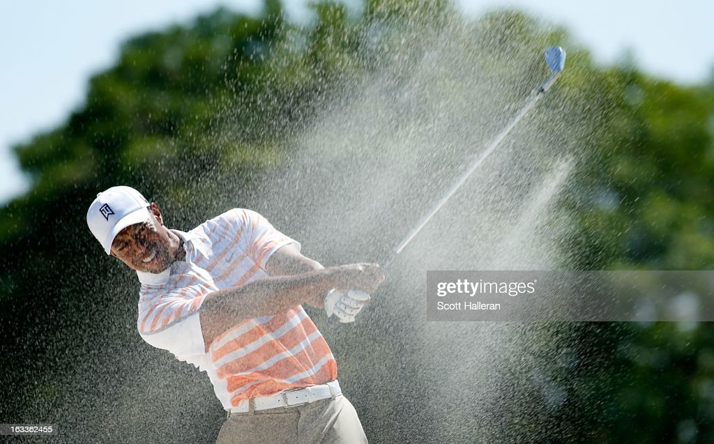 Tiger Woods plays a bunker shot on the first hole during the second round of the World Golf Championships-Cadillac Championship at the Trump Doral Golf Resort & Spa on March 8, 2013 in Doral, Florida.