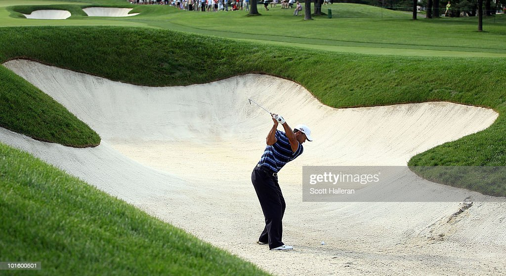 Tiger Woods plays a bunker shot on the tenth hole during the first round of the Memorial Tournament presented by Morgan Stanley at Muirfield Village Golf Club on June 3, 2010 in Dublin, Ohio.