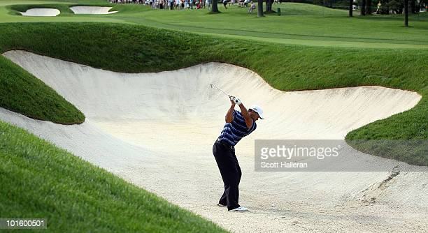Tiger Woods plays a bunker shot on the tenth hole during the first round of the Memorial Tournament presented by Morgan Stanley at Muirfield Village...