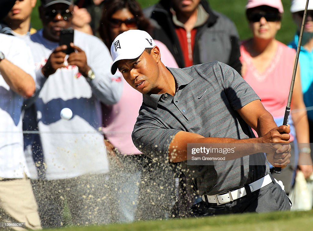 Tiger Woods plays a shot during a practice round prior to the World Golf ChampionshipsAccenture Match Play Championship at the The RitzCarlton Golf...