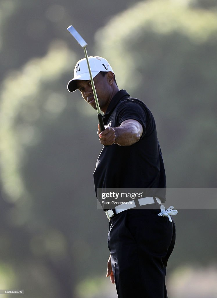 <a gi-track='captionPersonalityLinkClicked' href=/galleries/search?phrase=Tiger+Woods&family=editorial&specificpeople=157537 ng-click='$event.stopPropagation()'>Tiger Woods</a> plays a shot during the first round of the Arnold Palmer Invitational presented by MasterCard at the Bay Hill Club and Lodge on March 22, 2012 in Orlando, Florida.