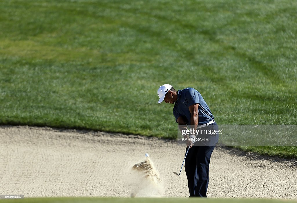 US Tiger Woods plays a shot during the second round of the Abu Dhabi Golf Championship at the Abu Dhabi Golf Club in the Emirati capital on January 18, 2013.