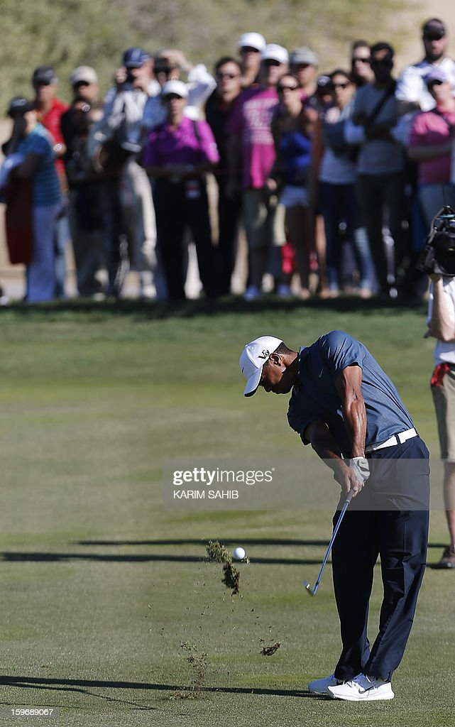 US Tiger Woods plays a shot during the second round of the Abu Dhabi Golf Championship at the Abu Dhabi Golf Club in the Emirati capital on January 18, 2013. AFP PHOTO/KARIM SAHIB