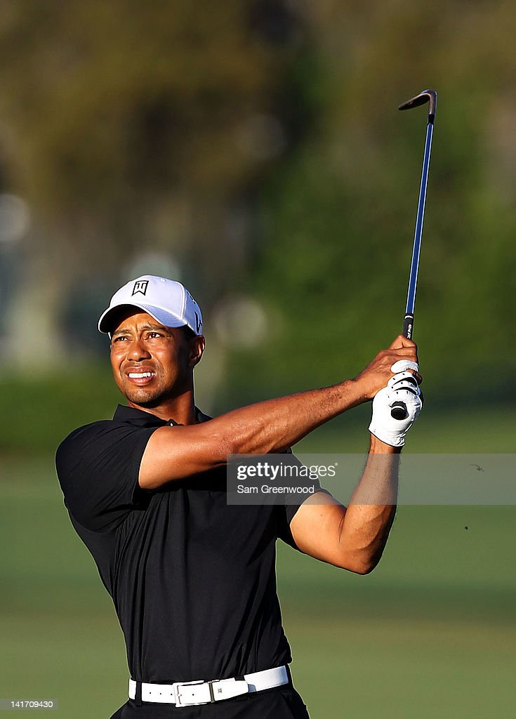 <a gi-track='captionPersonalityLinkClicked' href=/galleries/search?phrase=Tiger+Woods&family=editorial&specificpeople=157537 ng-click='$event.stopPropagation()'>Tiger Woods</a> plays a shot on the 10th hole during the first round of the Arnold Palmer Invitational presented by MasterCard at the Bay Hill Club and Lodge on March 22, 2012 in Orlando, Florida.