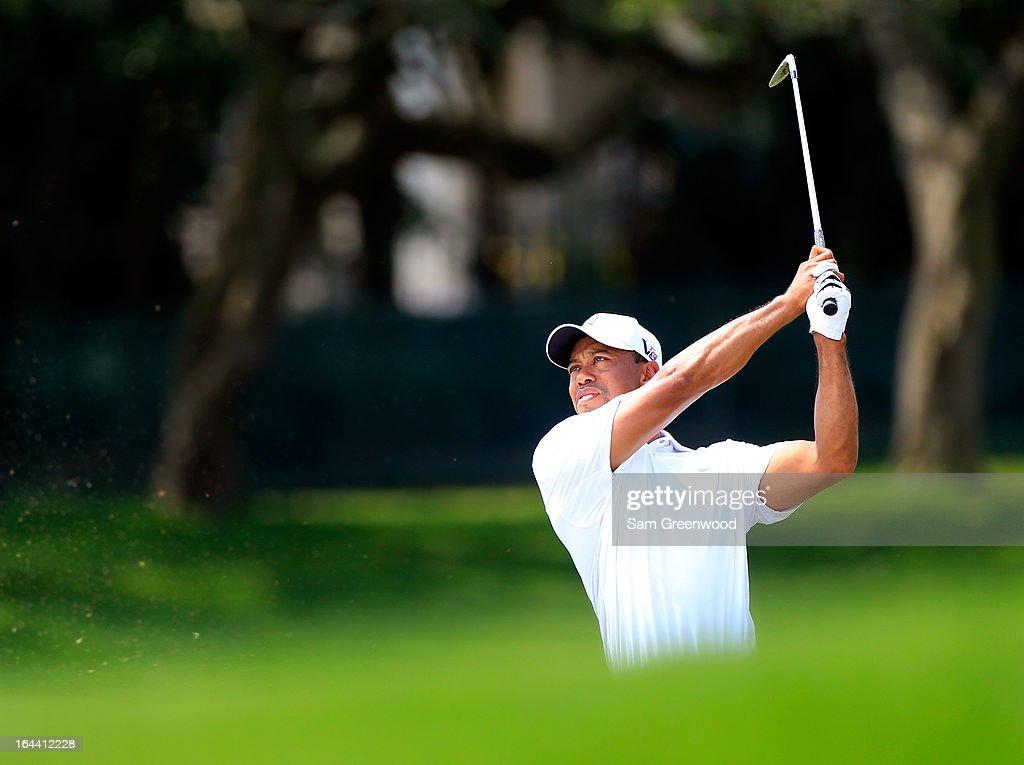 <a gi-track='captionPersonalityLinkClicked' href=/galleries/search?phrase=Tiger+Woods&family=editorial&specificpeople=157537 ng-click='$event.stopPropagation()'>Tiger Woods</a> plays a shot on the 5th hole during the third round of the Arnold Palmer Invitational presented by MasterCard at the Bay Hill Club and Lodge on March 23, 2013 in Orlando, Florida.