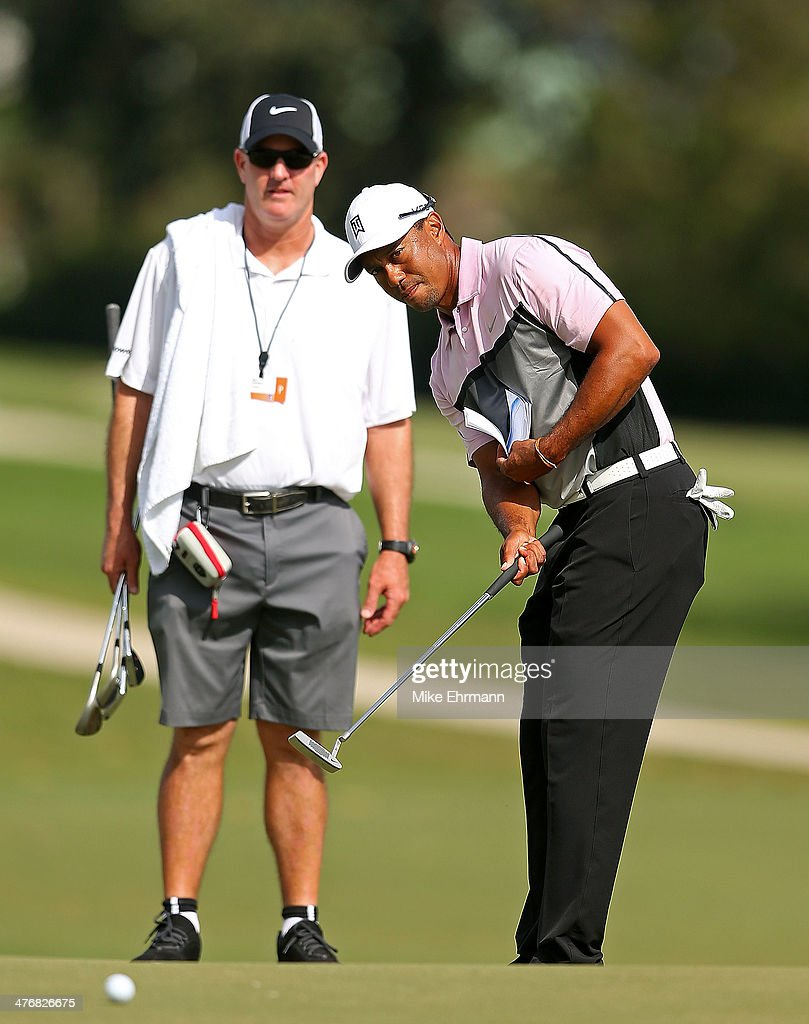 Tiger Woods plays during a practice round for the WGC Cadillac Championship at Trump National Doral on March 5, 2014 in Doral, Florida.
