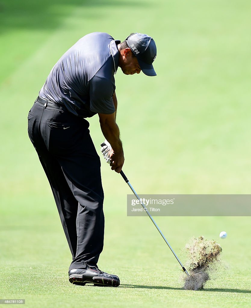 Tiger Woods plays from the fairway on the ninth hole during the second round of the Wyndham Championship at Sedgefield Country Club on August 21, 2015 in Greensboro, North Carolina.