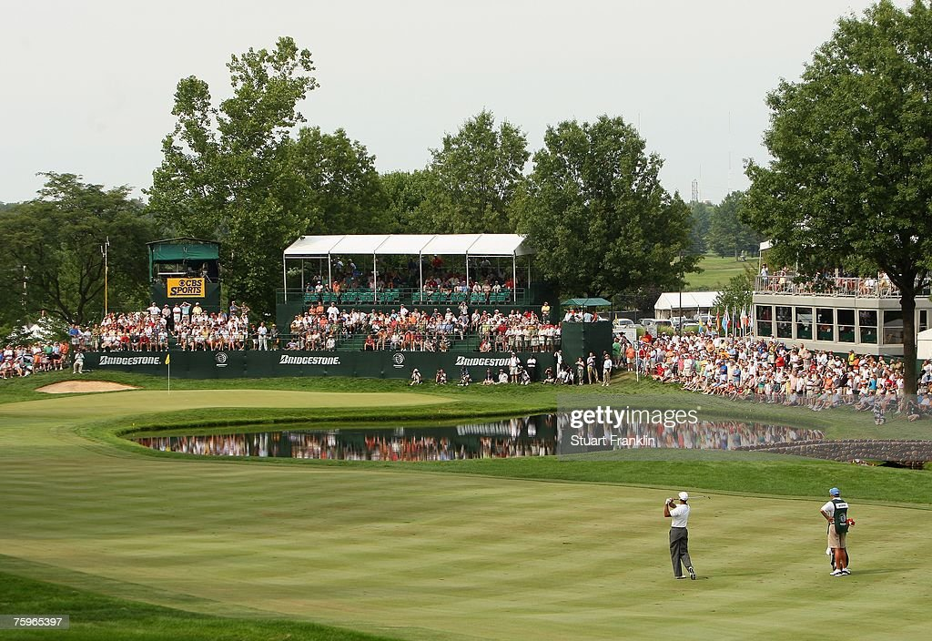 Tiger Woods plays his approach shot on the 16th hole during the third round of the WGCBridgestone Invitational on August 4 2007 at Firestone Country...