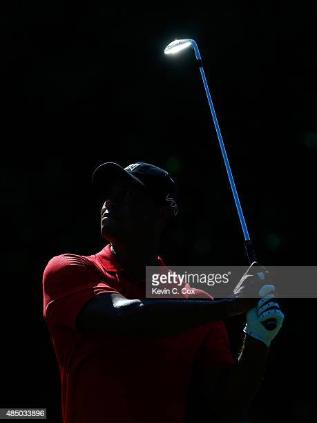 Tiger Woods plays his second shot on the 13th hole during the final round of the Wyndham Championship at Sedgefield Country Club on August 23 2015 in...
