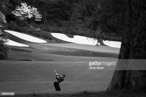 Tiger Woods plays his second shot on the 13th hole during the first round of the 2010 Masters Tournament at Augusta National Golf Club on April 8...
