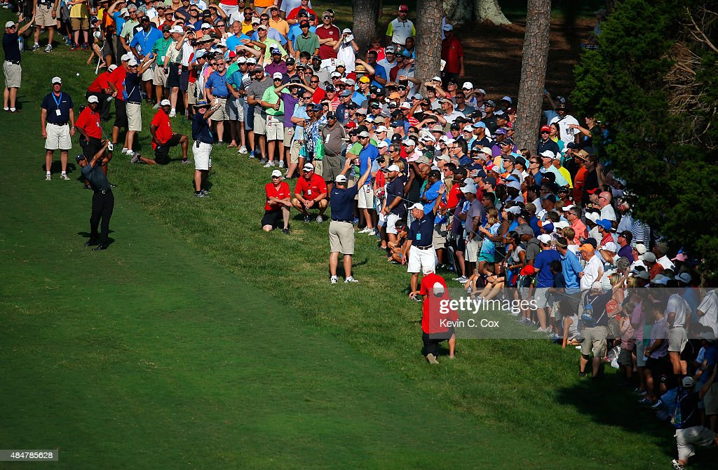Tiger Woods plays his second shot on the 18th hole during the second round of the Wyndham Championship at Sedgefield Country Club on August 21, 2015 in Greensboro, North Carolina.