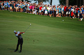 Tiger Woods plays his second shot on the 18th hole during the third round of the Wyndham Championship at Sedgefield Country Club on August 22 2015 in...