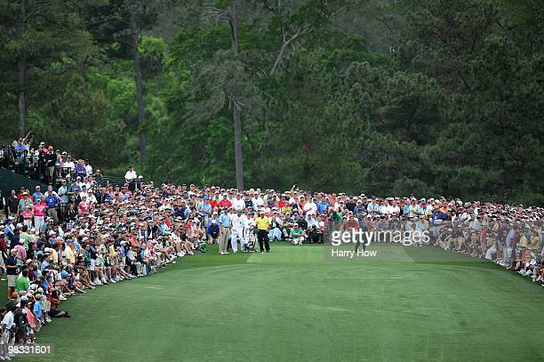 Tiger Woods plays his tee shot on the eighth hole in front of a gallery of fans during the first round of the 2010 Masters Tournament at Augusta...