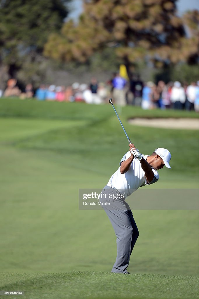 Tiger Woods plays his third shot on the 11th hole of the north course during the first round of the Farmers Insurance Open at Torrey Pines Golf Course on February 5, 2015 in La Jolla, California.