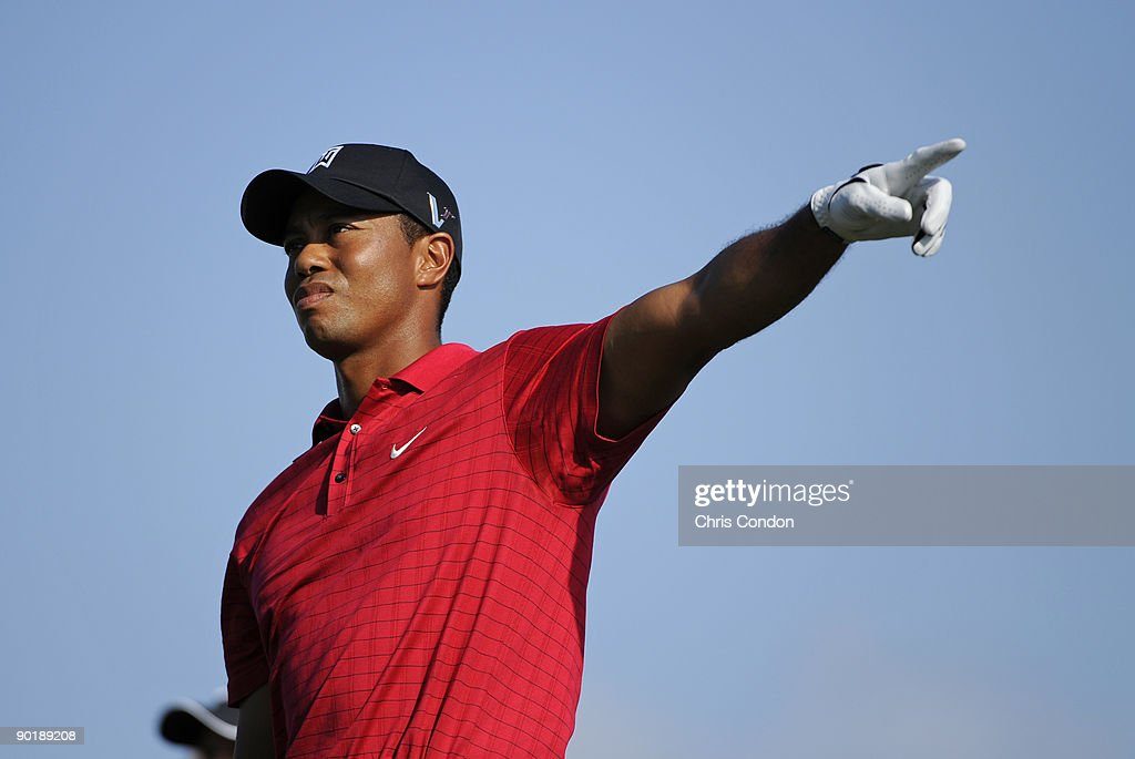 Tiger Woods points to an errant drive on during the final round of The Barclays at Liberty National Golf Club on August 30 2009 in Jersey City New...