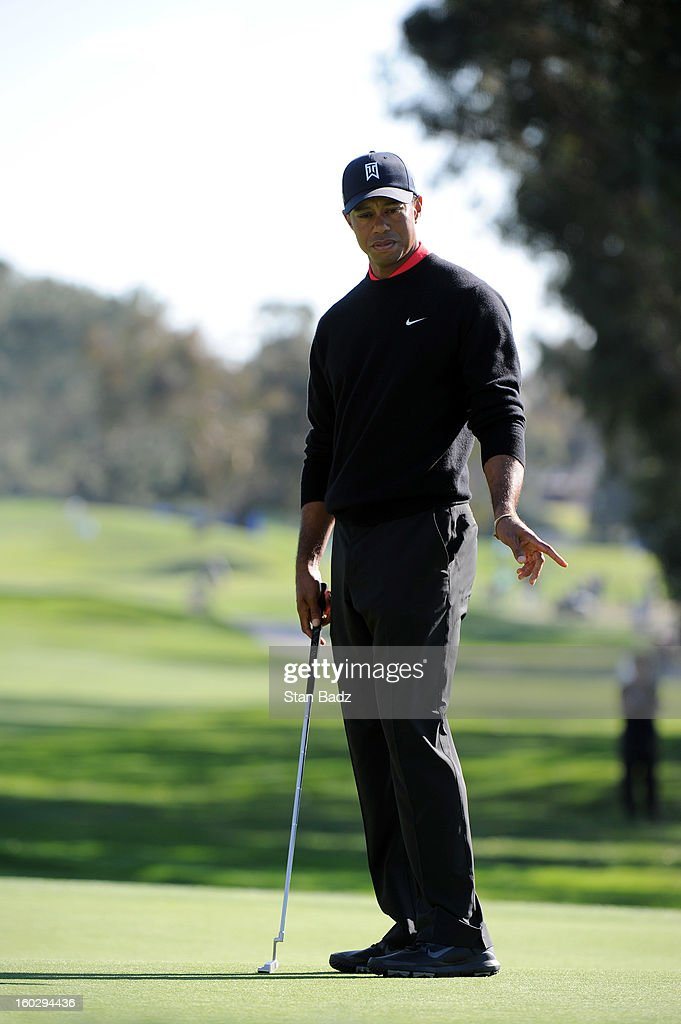 Tiger Woods points to his putt on the 15th green during the final round of the Farmers Insurance Open at Torrey Pines Golf Course on January 28, 2013 in La Jolla, California.