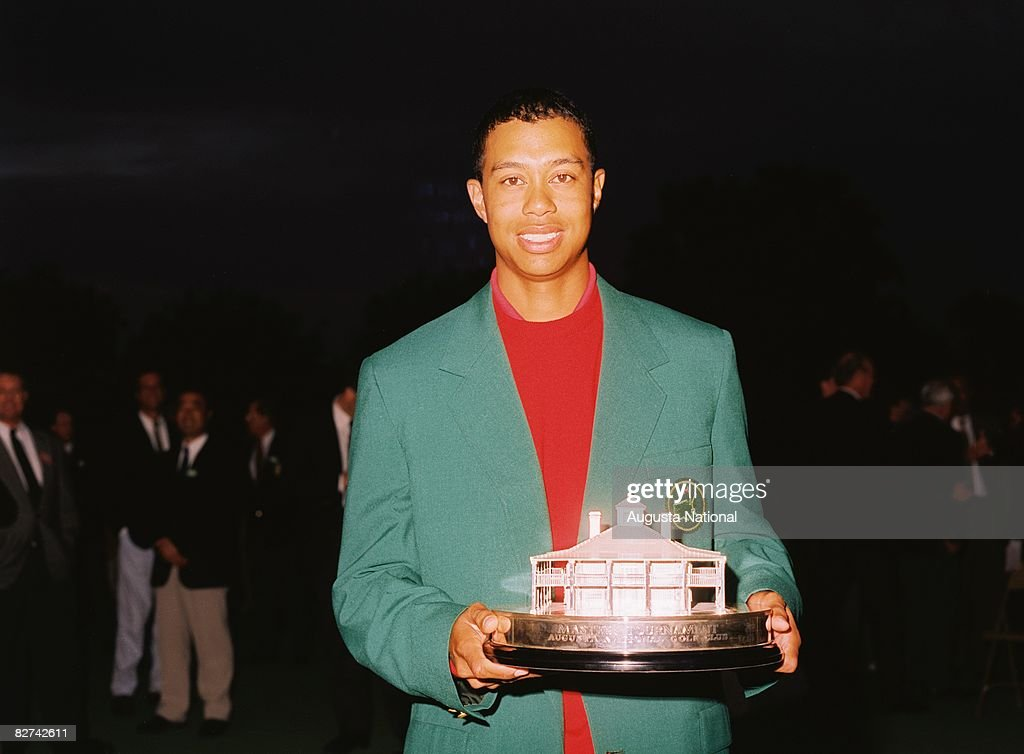 Tiger Woods poses with his trophy after the 1997 Masters Tournament at Augusta National Golf Club on April 13, 1997 in Augusta, Georgia.