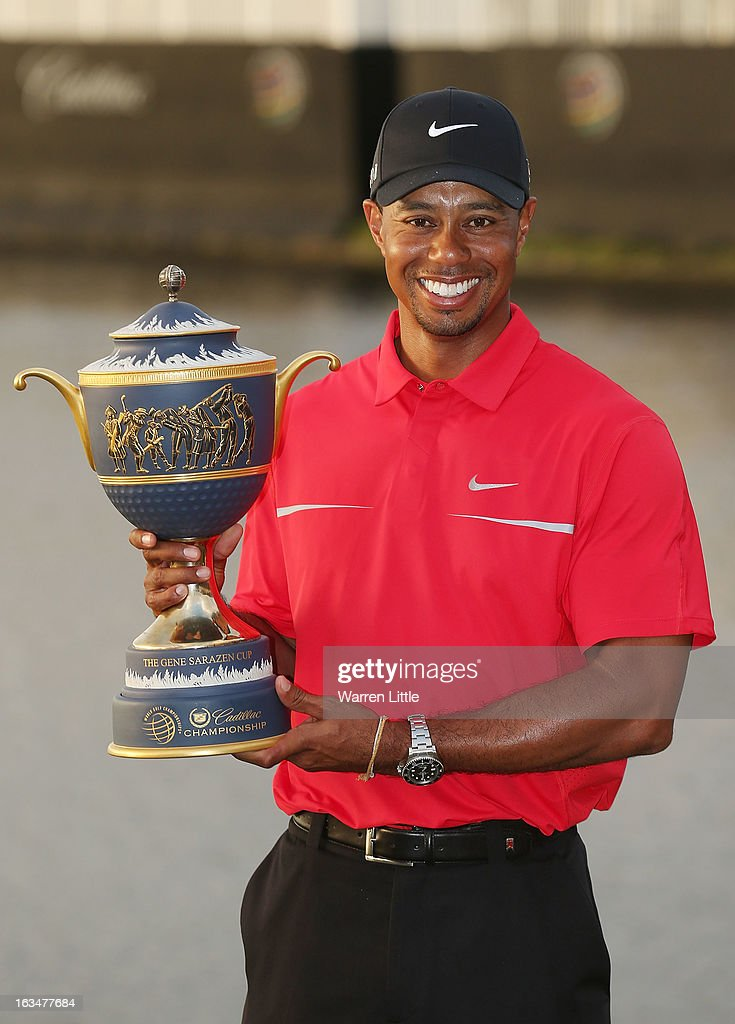 <a gi-track='captionPersonalityLinkClicked' href=/galleries/search?phrase=Tiger+Woods&family=editorial&specificpeople=157537 ng-click='$event.stopPropagation()'>Tiger Woods</a> poses with the Gene Sarazen Cup after his two-stroke victory at the World Golf Championships-Cadillac Championship at the Trump Doral Golf Resort & Spa on March 10, 2013 in Doral, Florida.