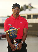 Tiger Woods poses with the Gene Sarazen Cup after his twostroke victory at the World Golf ChampionshipsCadillac Championship at the Trump Doral Golf...