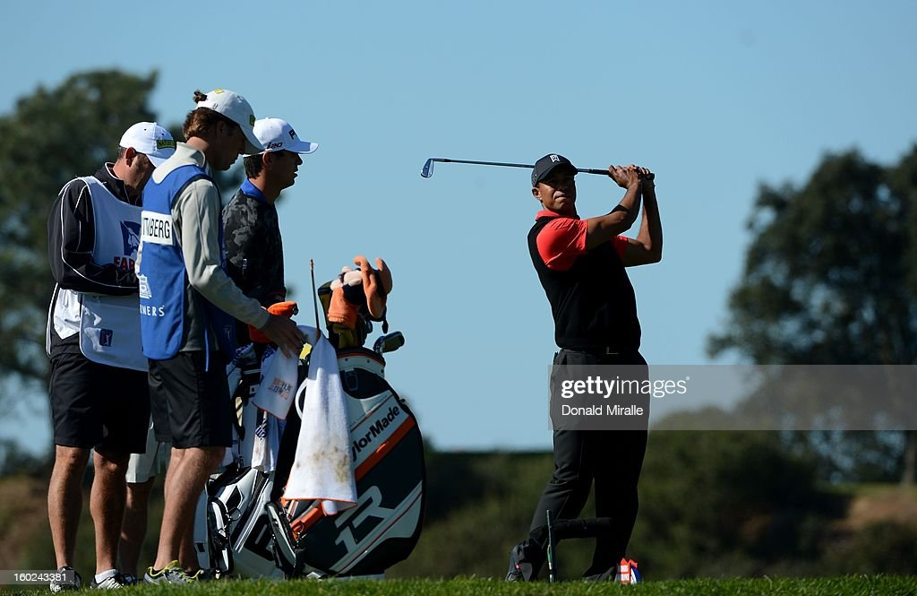 Tiger Woods practices his swing hits on the 8th tee during the Final Round at the Farmers Insurance Open at Torrey Pines Golf Course on January 28, 2013 in La Jolla, California.