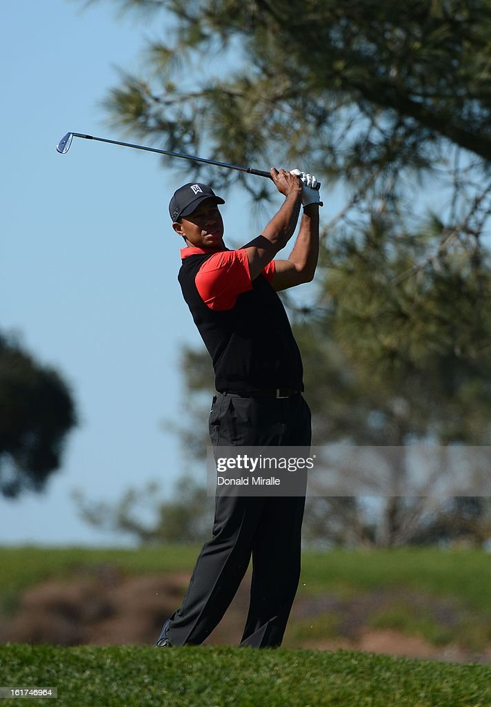 Tiger Woods practices his swing on the 8th tee during the Final Round at the Farmers Insurance Open at Torrey Pines Golf Course on January 28, 2013 in La Jolla, California.