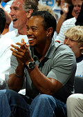 Tiger Woods professional golfer watches the Orlando Magic during Game Four of the Eastern Conference Semifinals against the Detroit Pistons during...