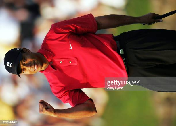 Tiger Woods pums his fist as he sinks the winning putt on the 18th green of the Ford Championship at Doral on March 6 2005 at the Doral Golf Resort...