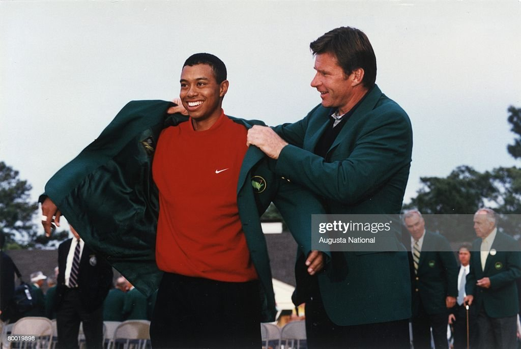 Tiger Woods Puts On The Green Jacket With The Help Of Nick Faldo At The Presentation Ceremony Of The 1997 Masters Tournament