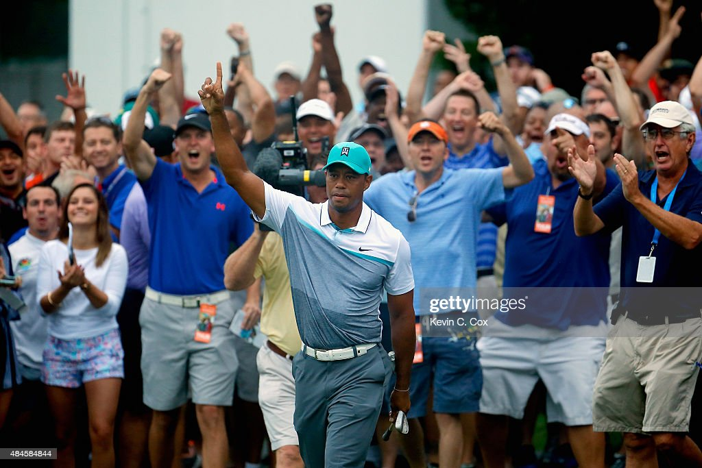 Tiger Woods reacts after chipping in for birdie on the 10th hole during the first round of the Wyndham Championship at Sedgefield Country Club on August 20, 2015 in Greensboro, North Carolina.