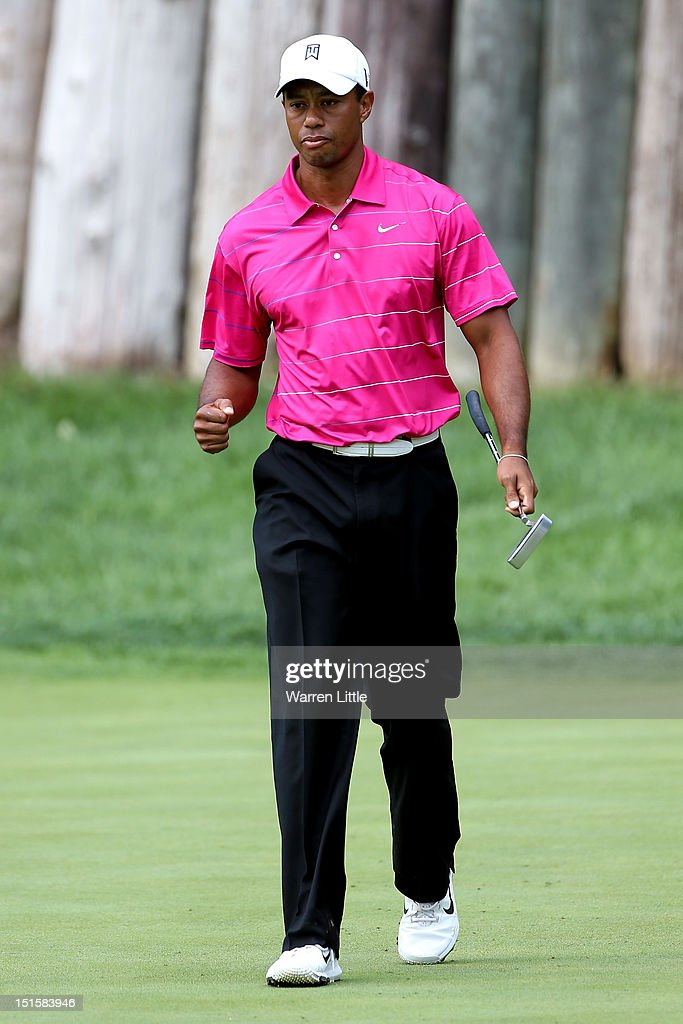 <a gi-track='captionPersonalityLinkClicked' href=/galleries/search?phrase=Tiger+Woods&family=editorial&specificpeople=157537 ng-click='$event.stopPropagation()'>Tiger Woods</a> reacts after he made a birdie putt on the sixth green during the third round of the BMW Championship at Crooked Stick Golf Club on September 8, 2012 in Carmel, Indiana.