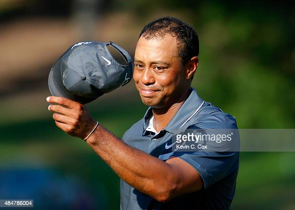 Tiger Woods reacts after his par putt on the 18th green during the second round of the Wyndham Championship at Sedgefield Country Club on August 21...