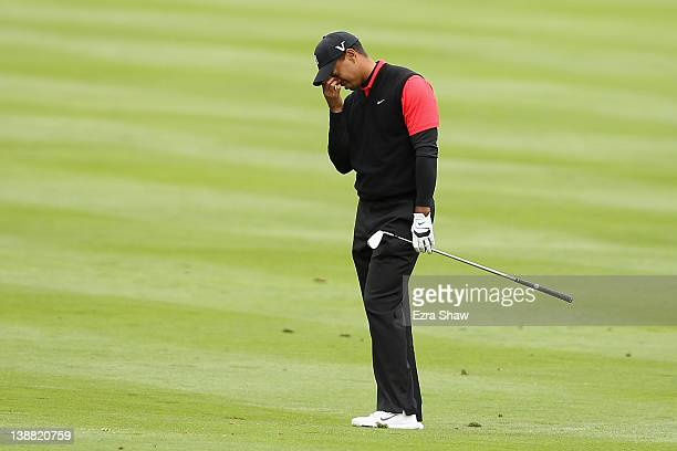 Tiger Woods reacts after hitting his second shot on the 14th hole during the final round of the ATT Pebble Beach National ProAm at Pebble Beach Golf...