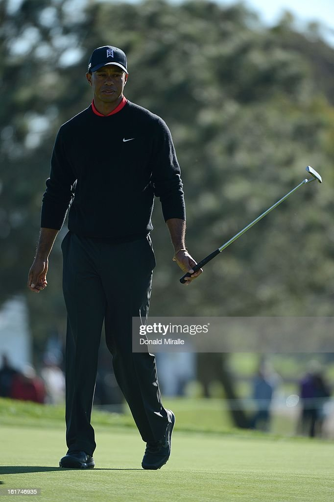 Tiger Woods reacts after hitting the ball on the green during the Final Round at the Farmers Insurance Open at Torrey Pines Golf Course on January 28, 2013 in La Jolla, California.